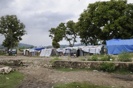 tent city: LEOGANE - AUGUST 27: A small tent city of around 100 residents on August 27, 2010 in Leogane, Haiti