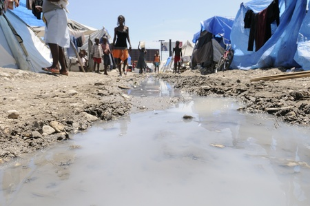 pollution water: PORT-AU-PRINCE - AUGUST 28: The tent cities are devoid of any proper sanitation and sewerage system, in Port-Au-Prince, Haiti on August 28, 2010.