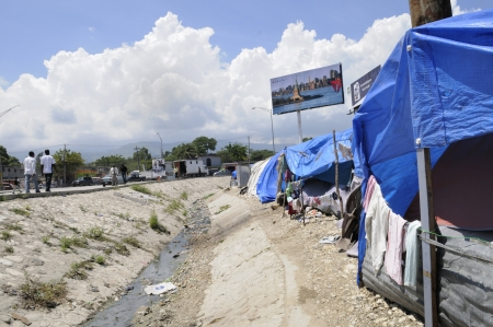 tent city: PORT-AU-PRINCE - AUGUST 28: Backside of a tent city facing the highway in Port-Au-Prince, Haiti on August 28, 2010.