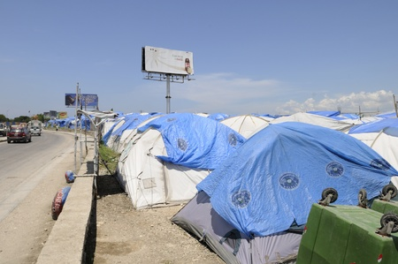 PORT-AU-PRINCE - AUGUST 28: A tent city beside the highway in Port-Au-Prince, Haiti on August 28, 2010.