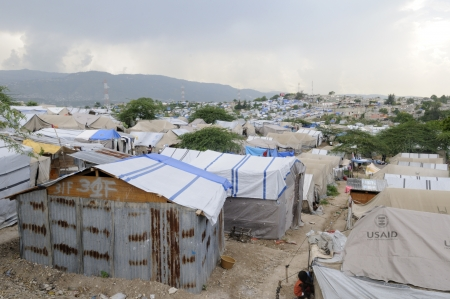 PORT-AU-PRINCE - AUGUST 28: Damaged Tents are also reconstructed with Tins instead of plastic as plastic tents are expensive, on August 28, 2010 in Port-Au-Prince, Haiti Editorial