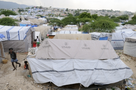 PORT-AU-PRINCE - AUGUST 28: People walking on the walkways of a tent city, on August 28, 2010 in Port-Au-Prince, Haiti Editorial