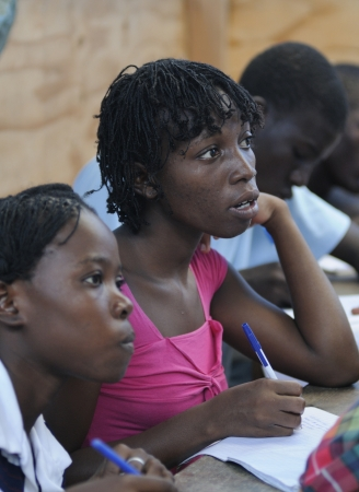 CITE SOLEIL- AUGUST 25: Young girls in their classroom in a local community school in Cite Soleil- one of the poorest area in the Western Hemisphere on August 25 2010 in Cite Soleil, Haiti.