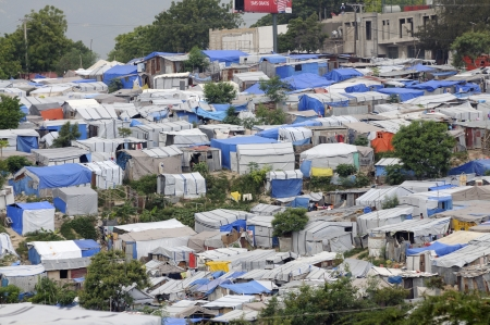 tent city: PORT-AU-PRINCE - AUGUST 28: An huge amount of area of the capital of Haiti is occupied by Tents on August 28, 2010 in Port-Au-Prince, Haiti