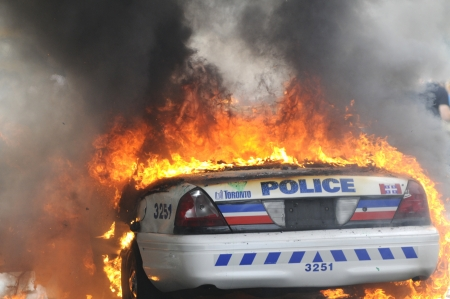 TORONTO-JUNE 26: A burning police car during the G20 Protest on June 26, 2010 in Toronto, Canada.