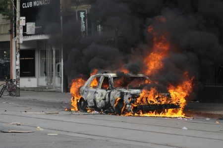 TORONTO-JUNE 26: A police car burning on queen street during the G20 Protest on June 26, 2010 in Toronto, Canada. Editorial