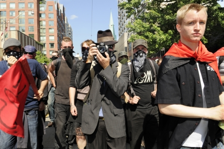 anarchist: TORONTO-JUNE 25: The black anarchist group who was later accused of vandalizing shops and store during the G20 Protest on June 25, 2010 in Toronto, Canada.