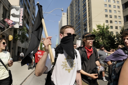 anarchist: TORONTO-JUNE 25: Members of The black anarchist group who was later accused of vandalizing shops and store during the G20 Protest on June 25, 2010 in Toronto, Canada.