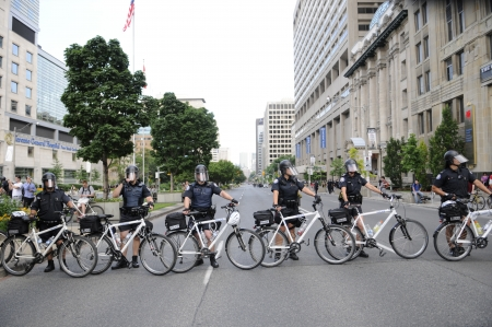 restricting: TORONTO-JUNE 25: Toronto Cycle Police restricting the protesters from entering the actual G20 summit perimeter on University Avenue during the G20 Protest on June 25, 2010 in Toronto, Canada.