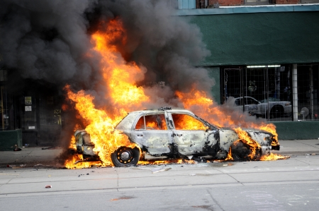 TORONTO-JUNE 26: A police car burning after being torched by the protesters during the G20 Protest on June 26, 2010 in Toronto, Canada.