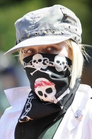 g20: TORONTO-JUNE 25: An activist wearing a skull bandana mask during the G20 Protest on June 25, 2010 in Toronto, Canada. Editorial