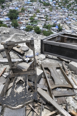 Collapsed furniture on top of a hill, in Port-Au-Prince, Haiti   photo