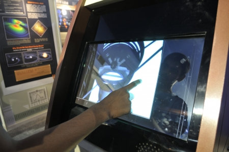 KOLKATA- FEBRUARY 20: A human finger plays around with a touch screen, during the Information and Communication Technology (ICT) conference and exhibition in Kolkata, India on February 20, 2011.