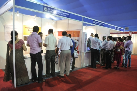 KOLKATA- FEBRUARY 20: People gathering information from a booth of Birla Museum,during the Information and Communication Technology conference and exhibition on February 20, 2011 in Kolkata, India.