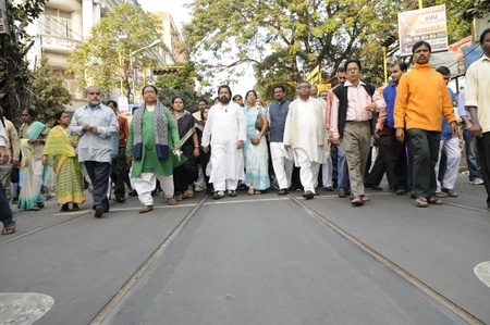 KOLKATA- DECEMBER 20: Sudip Banerjee- chief spokesperson of Trinamool Congress in the Indian Parliament walking during a rally with supporters corpse in Kolkata, India on December 20, 2010.