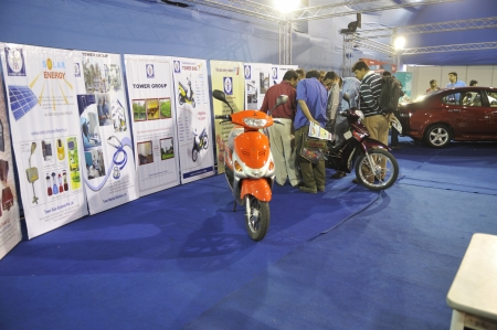 flocking: KOLKATA- FEBRUARY 20: People flocking around a scooter that runs on solar energy at the Information and Communication Technology (ICT) conference and exhibition in Kolkata, India on February 20,2011.