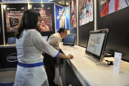 KOLKATA- FEBRUARY 20: A visitor looks into the specification of a HP DreamScreen, during the Information and Communication Technology conference and exhibition in Kolkata, India on February 20, 2011.