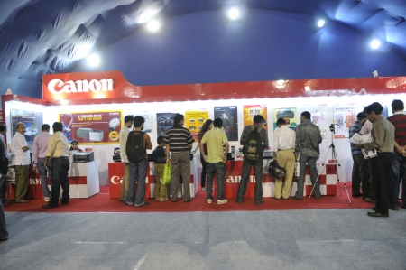 flocking: KOLKATA- FEBRUARY 20: Consumers flocking inside a CANON booth, during the Information and Communication Technology (ICT) conference and exhibition in Kolkata, India on February 20, 2011.