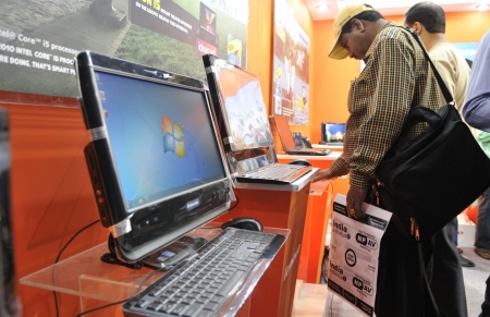 KOLKATA- FEBRUARY 20: A viewer looks carefully at a Lenovo desktop, during the Information and Communication Technology (ICT) conference and exhibition in Kolkata, India on February 20, 2011. Editorial