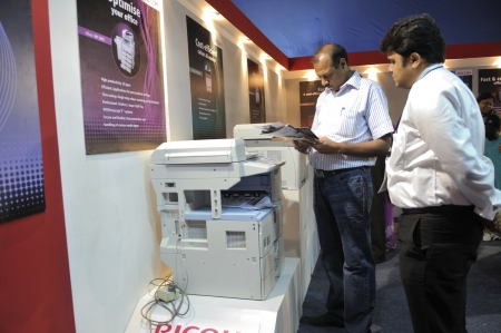KOLKATA- FEBRUARY 20: A customer reading the brochure of a photocopier, during the Information and Communication Technology (ICT) conference and exhibition in Kolkata, India on February 20, 2011.
