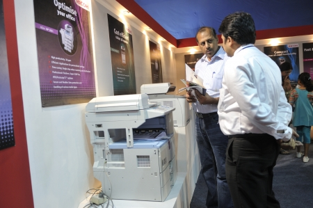 KOLKATA- FEBRUARY 20: A customer asking questions about a photocopier, during the Information and Communication Technology (ICT) conference and exhibition in Kolkata, India on February 20, 2011.