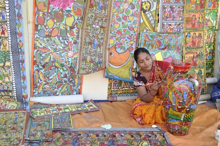 KOLKATA- FEBRUARY 23: A rural woman painting a pot during the Handicraft Fair on February 23, 2011 in Kolkata, India. Editorial