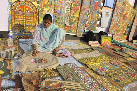 KOLKATA- FEBRUARY 23: A Rural artist painting a T-shirt, during the Handicraft Fair on February 23, 2011 in Kolkata, India.
