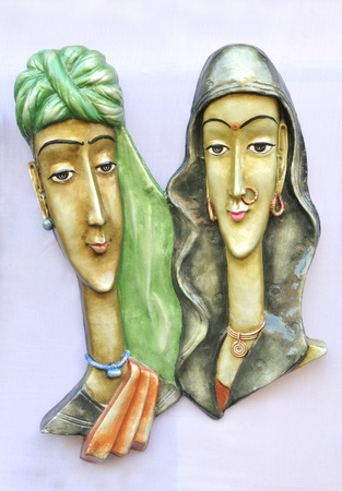 KOLKATA - FEBRUARY 23: Sculptures hanging on a wooden board during the Handicraft Fair-the biggest of its kind in Asia on February 23, 2011 in Kolkata, India.