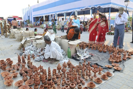 KOLKATA- FEBRUARY 23:Customers buying clay utensils from one of the vendors during the Handicraft Fair on February 23, 2011 in Kolkata, India.