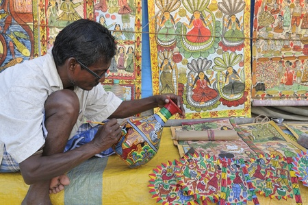KOLKATA- FEBRUARY 23: An old man painting a pottery ,during the Handicraft Fair on February 23, 2011 in Kolkata, India.