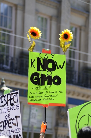 modifying: TORONTO-MAY 25: An activist holding a sign asking to say no to GMO