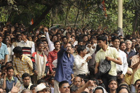 KOLKATA - FEBRUARY 20: Audiences enjoying the speeches during a rally of All India Trinamool Congress ,organized to kick the 2011 election champagne, in Kolkata, India on February 20, 2011.