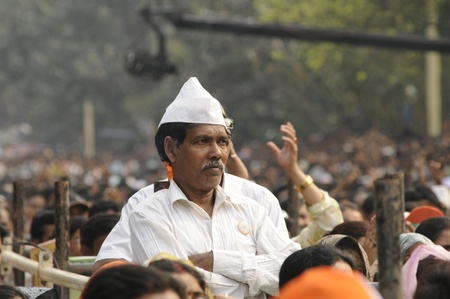 KOLKATA - FEBRUARY 20: A supporter listening to the speeches during a rally of All India Trinamool Congress ,organized to kick the 2011 election campagne, in Kolkata, India on February 20, 2011.