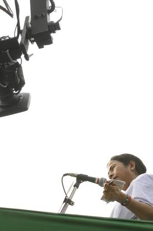 statesman: KOLKATA - FEBRUARY 20: A camera follows Indian Railways minister Ms. Mamata Banerjee while she speaks during a political rally in Kolkata, India on February 20, 2011.