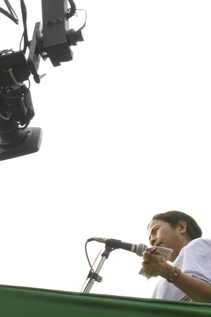 KOLKATA - FEBRUARY 20: A camera follows Indian Railways minister Ms. Mamata Banerjee while she speaks during a political rally in Kolkata, India on February 20, 2011.