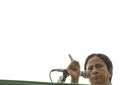 rally finger: KOLKATA - FEBRUARY 20: Indian Railways minister and supremo of All India Trinamool Congress Ms.Mamata Banerjee addressing her follwers during a political rally in Kolkata, India on February 20, 2011.