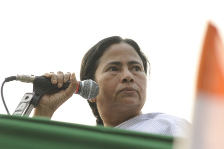KOLKATA - FEBRUARY 20: Indian Railways minister Ms. Mamata Banerjee looking looking angrily to one of her supporters who misbehaved during a political rally in Kolkata, India on February 20, 2011. Editorial