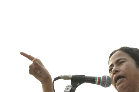 rally finger: KOLKATA - FEBRUARY 20: Indian Railways minister Ms. Mamata Banerjee pointing towards the audience while giving her speech during a political rally in Kolkata, India on February 20, 2011.
