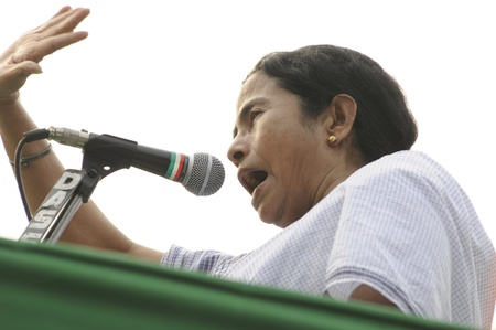 political rally: KOLKATA - FEBRUARY 20: Indian Railways minister Ms. Mamata Banerjee in an agitated mood while giving her speech during a political rally in Kolkata, India on February 20, 2011.