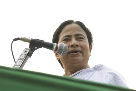 political rally: KOLKATA - FEBRUARY 20: Indian Railways minister Ms. Mamata Banerjee sharing a rare laugh while giving her speech during a political rally in Kolkata, India on February 20, 2011.