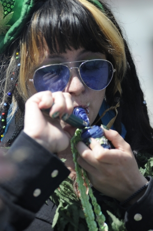 legalization: TORONTO - APRIL 20: A teenage girl lighting her marijuana pepe during the annual marijuana 420 event at Yonge & Dundas Square on April 20 2012 in Toronto, Canada. Editorial
