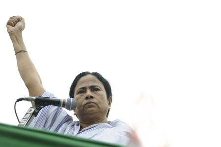 KOLKATA - FEBRUARY 20: Indian Railways minister Ms. Mamata Banerjee gesturing a sign of solidarity during a political rally in Kolkata, India on February 20, 2011. Editorial