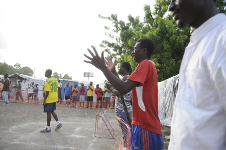 PORT-AU-PRINCE - AUGUST 26: Residents applauding a local team during a friendly soccer match in Port-Au-Prince, Haiti on August 26, 2010.