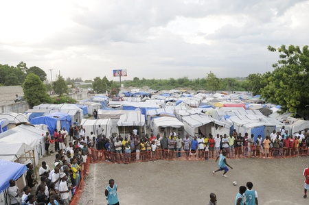 PORT-AU-PRINCE - AUGUST 26: Resident enjoying one of their primary form of entertainment- a soccer game in one of the tent cities in Port-Au-Prince, Haiti on August 26, 2010.