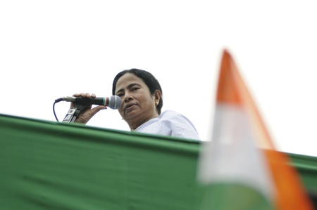 political rally: KOLKATA - FEBRUARY 20: Indian Railways minister Ms. Mamata Banerjee looking at the audience while giving her speech during a political rally in Kolkata, India on February 20, 2011. Editorial