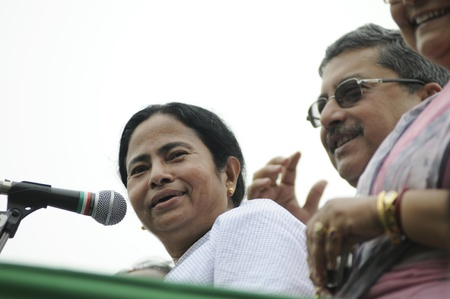 KOLKATA - FEBRUARY 20: Indian Railways minister Ms. Mamata Banerjee sharing a laugh with her party leaders during a political rally organized by her party, in Kolkata, India on February 20, 2011. Editorial