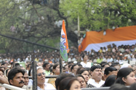 KOLKATA - FEBRUARY 20: Audiences listening to the speeches during a rally of All India Trinamool Congress ,organized to kick the 2011 election campagne, in Kolkata, India on February 20, 2011.