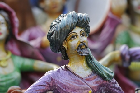 KOLKATA - FEBRUARY 23: An abstract art of a tribal man made out of clay ,on display during the Handicraft Fair in Kolkata-the biggest of its kind in Asia on February 23,2011 in Kolkata,India. Editorial