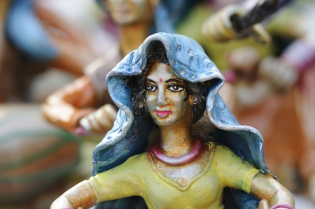 KOLKATA - FEBRUARY 23: An abstract art of a tribal woman made out of clay ,on display during the Handicraft Fair in Kolkata-the biggest of its kind in Asia on February 23,2011 in Kolkata,India. Editorial