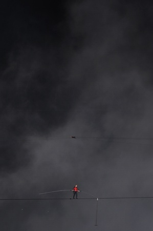 daredevil: NIAGARA FALLS -JUNE 15: Nik Wallanda on a rope that is only 5 centimeters wide while crossing the Niagara Falls on a tightrope on June 15 2012 in Niagara Falls, Canada.
